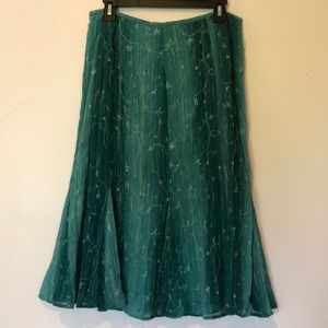 Teal skirt with flouncy flair! Size 10 petite.